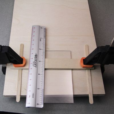 measuring a plexiglass with a ruler
